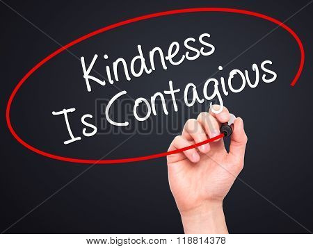 Man Hand Writing Kindness Is Contagious With Black Marker On Visual Screen