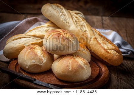 Several Kaiser Rolls And Baquette.