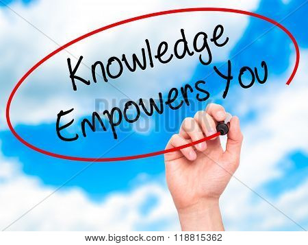 Man Hand Writing Knowledge Empowers You With Black Marker On Visual Screen