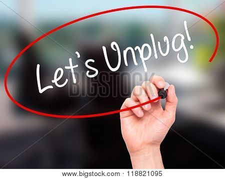 Man Hand Writing Let's Unplug! With Black Marker On Visual Screen