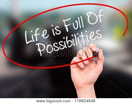 Man Hand Writing Life Is Full Of Possibilities With Black Marker On Visual Screen