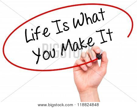 Man Hand Writing Life Is What You Make It With Black Marker On Visual Screen