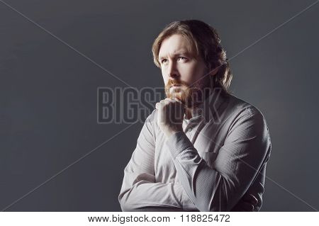bearded young man with surprised expression
