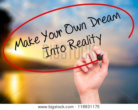 Man Hand Writing Make Your Own Dream Into Reality With Black Marker On Visual Screen