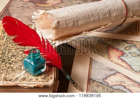 Quill Pen And A Papyrus Sheet