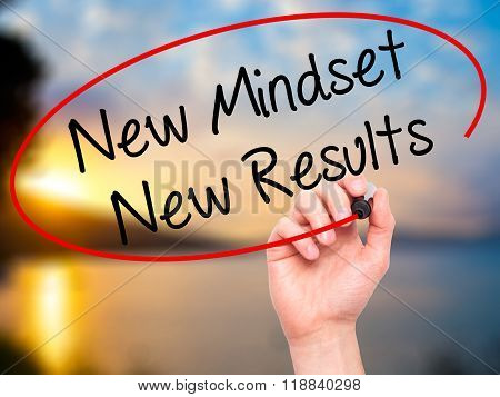 Man Hand Writing New Mindset New Results With Black Marker On Visual Screen