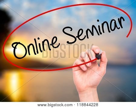 Man Hand Writing Online Seminar With Black Marker On Visual Screen