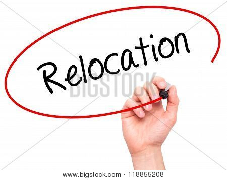 Man Hand Writing Relocation  With Black Marker On Visual Screen