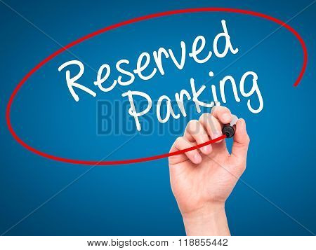 Man Hand Writing Reserved Parking With Black Marker On Visual Screen