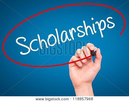 Man Hand Writing Scholarships With Black Marker On Visual Screen