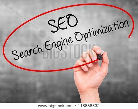 Man Hand Writing Seo Search Engine Optimization With Black Marker On Visual Screen