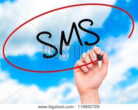 Man Hand Writing  Sms (short Message Service)  With Black Marker On Visual Screen