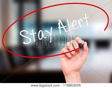 Man Hand Writing Stay Alert With Black Marker On Visual Screen