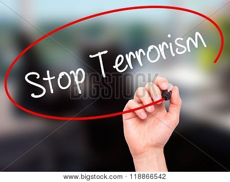 Man Hand Writing Stop Terrorism With Black Marker On Visual Screen