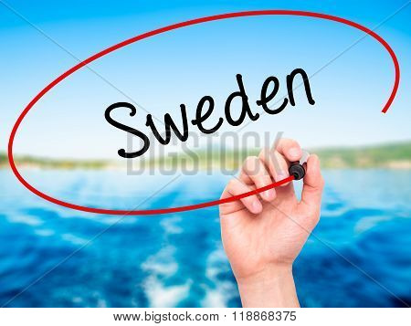 Man Hand Writing Sweden  With Black Marker On Visual Screen