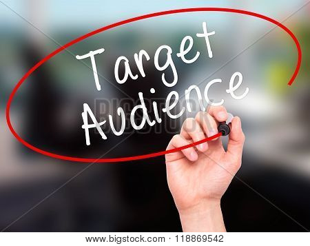 Man Hand Writing Target Audience With Black Marker On Visual Screen