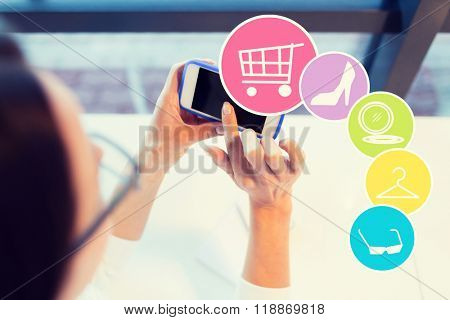 business, people, technology and online shopping concept - close up of young woman in eyeglasses with smartphone and internet icons at office