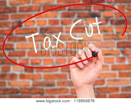 Man Hand Writing Tax Cut With Black Marker On Visual Screen