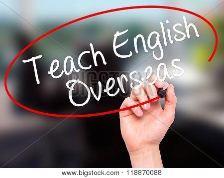 Man Hand Writing Teach English Overseas With Black Marker On Visual Screen