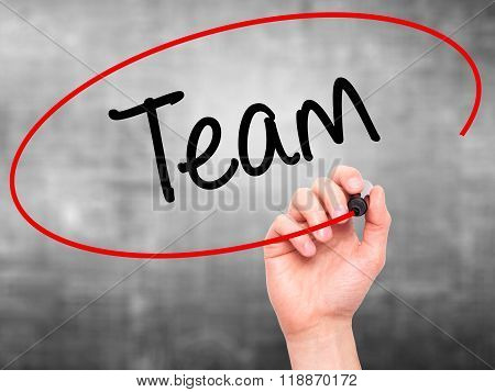 Man Hand Writing Team With Black Marker On Visual Screen