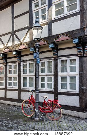 Red bicycle in front of a half-timbered building