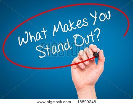 Man Hand Writing What Makes You Stand Out? With Black Marker On Visual Screen