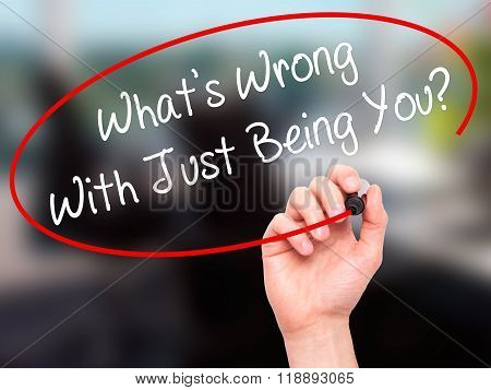 Man Hand Writing What's Wrong With Just Being You? With Black Marker On Visual Screen