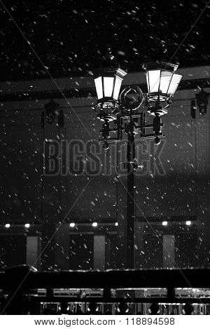 Light street lamp during a snow storm