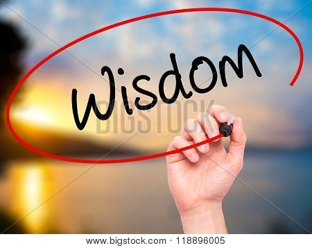 Man Hand Writing Wisdom With Black Marker On Visual Screen