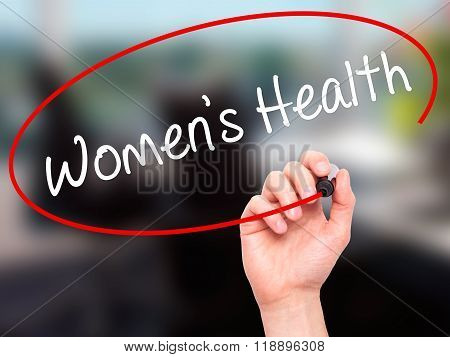 Man Hand Writing Women's Health With Black Marker On Visual Screen