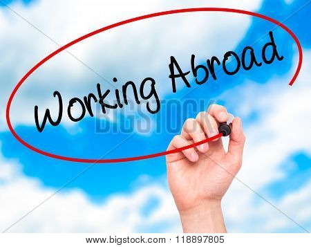 Man Hand Writing Working Abroad With Black Marker On Visual Screen