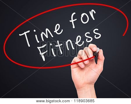Man Hand Writing Time For Fitness With Marker On Transparent Wipe Board
