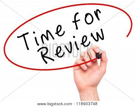 Man Hand Writing Time For Review With Marker On Transparent Wipe Board
