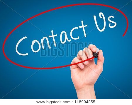 Man Hand Writing Contact Us With Marker On Transparent Wipe Board Isolated On Blue