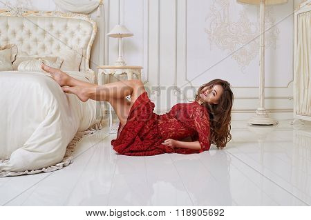 Fashion portrait of elegant young woman in a luxurious interior