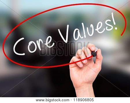 Man Hand Writing Core Values With Marker On Transparent Wipe Board