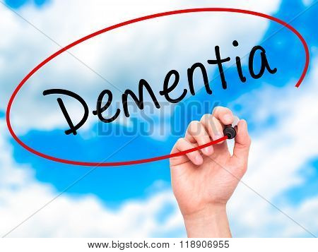 Man Hand Writing Dementia With Marker On Transparent Wipe Board