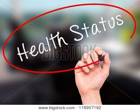 Man Hand Writing Health Status On Visual Screen