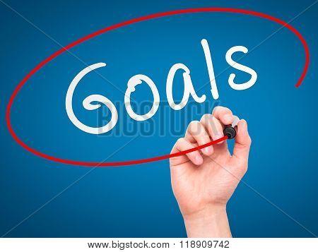 Man Hand Writing Goals On Visual Screen