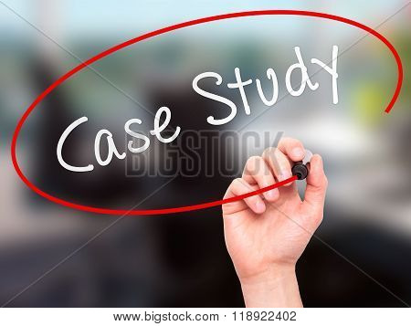 Man Hand Writing Case Study With Marker On Transparent Screen