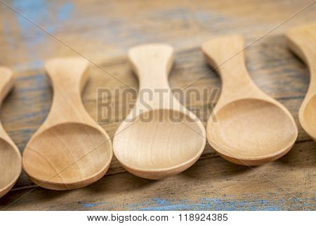 spoon abstract - a row of empty wooden tablespoon with a shallow depth of field