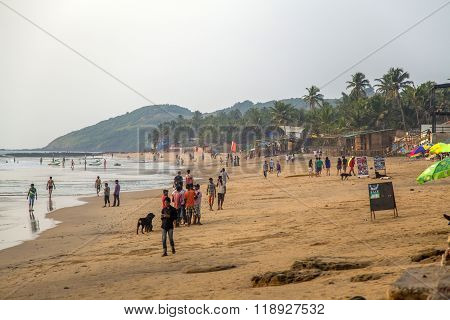 ANJUNA, INDIA - OCTOBER 14, 2015: Unindentified people on the beach at Anjuna India. Anjuna is world famous for its trance parties held on the beach during the tourist season.
