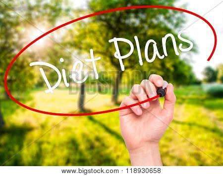 Man Hand Writing  Diet Plans  With Black Marker On Visual Screen