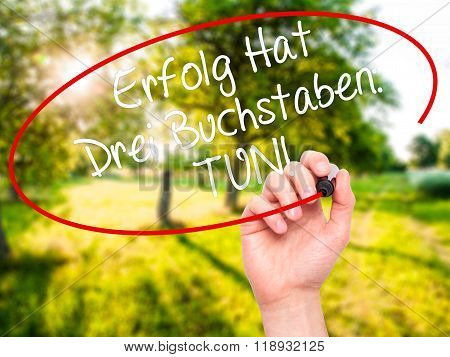Man Hand Writing Erfolg Hat Drei Buchstaben: Tun! (success Has Three Letters: Do In German) With Bla