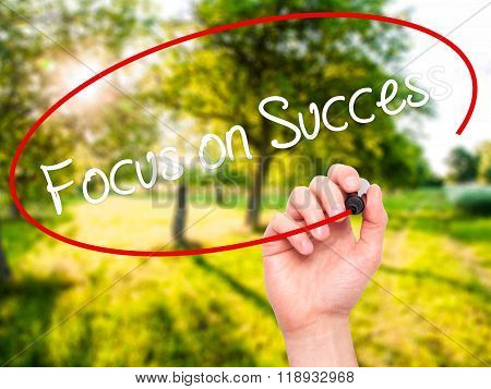Man Hand Writing Focus On Success With Black Marker On Visual Screen