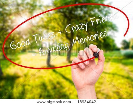 Man Hand Writing Good Times + Crazy Friends = Amazing Memories With Black Marker On Visual Screen