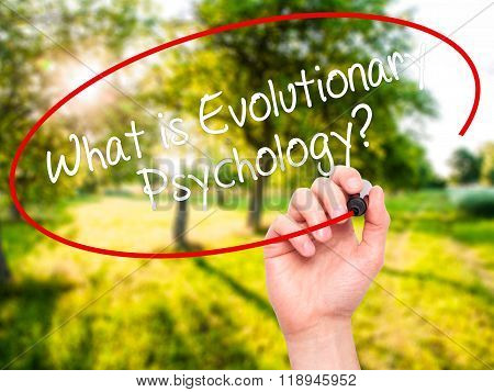 Man Hand Writing What Is Evolutionary Psychology? With Black Marker On Visual Screen
