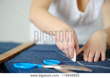 Tailoring Of Natural Wool. Woman Tailors Sewing Fabric.