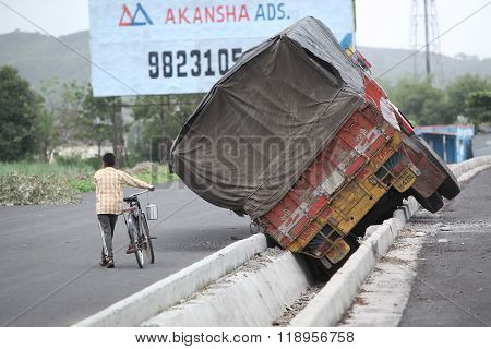 Pune, India - June 27, 2015: An Truck That Went Out Of Control On An Indian Highway And Fell In Stor