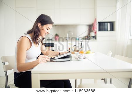 Modern woman lifestyle-healthy fitness breakfast,coffee and fruit